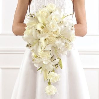 A white cascade bouquet with roses, calla lilies and lilies.  I like all the different shaped flowers - it sort of reminds me of a wild flower bouquet.