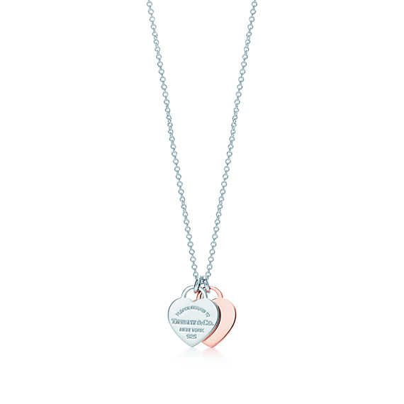 Return to Tiffany® double heart pendant in RUBEDO® metal and silver, mini. | Tiffany & Co.