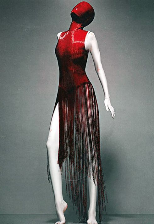 McQueen fashion couture designer. His designs were art!! He will be missed!