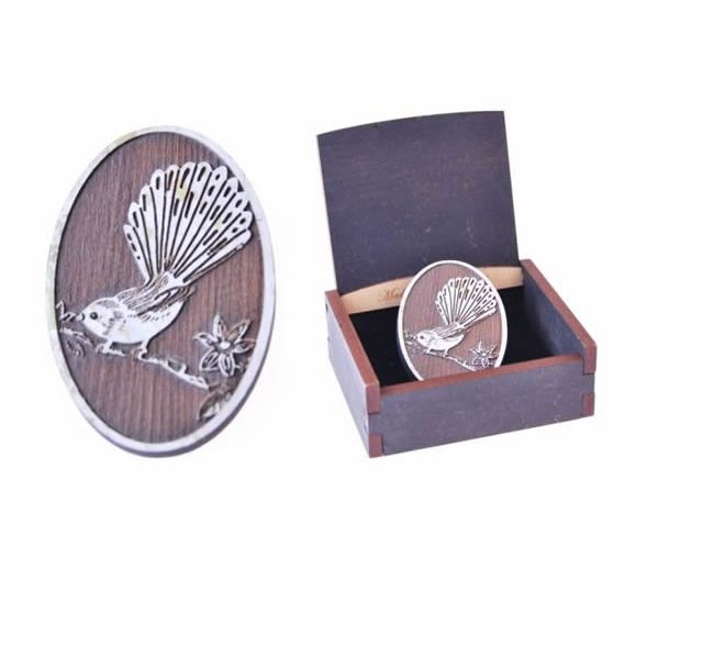 Born again fantail cameo brooch by Ian Blackwell New Zealand. Made in New Zealand from recycled Kauri.   Gifts online, flying fish design nz