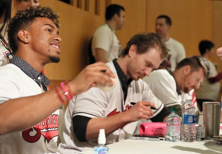 Cleveland Indians Francisco Lindor, and pitchers Josh Tomlin and Bryan Shaw sign autographs at the 2017 TribeFest held at the InterContinental Hotel at the Cleveland Clinic, in Cleveland, Ohio, on Jan. 28, 2017. (Chuck Crow/The Plain Dealer)