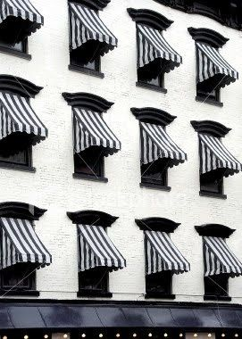 black and white stripped awnings western wall