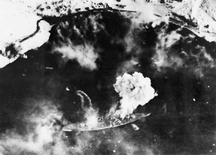 An Arial recononsence flight picture shows the Tirpitz on time on impact with the British torpedoes.