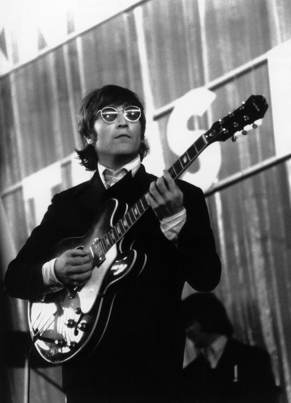 John Lennon and the Beatles perform at Ernst Merck Halle in Germany, 1966.