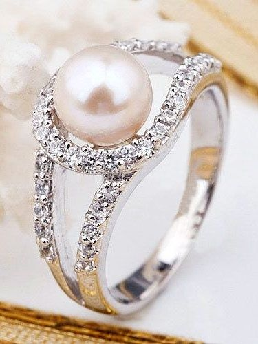 Pearl ring- very pretty! But remember boys and girls, the old wives tale about pearl engagement rings.