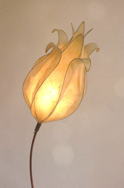 Tall Curved Faith Light in cream by Colin Chetwood. Lamp Height 170 cm.  Tall, curved stem with beaten copper base and cream tissue paper shade. Ideal for use as a...