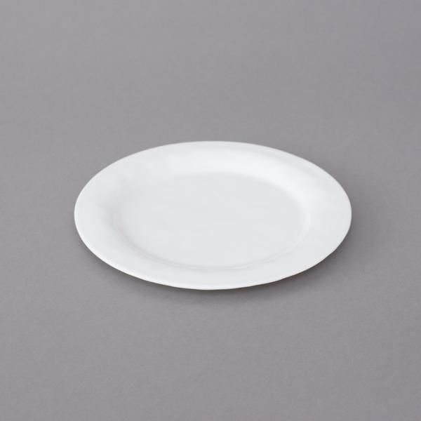 Kajsa Cramer Small White Porcelain Plate : Made from exclusive porcelain clay, Kajsa Cramers small plates are contemporary, stylish and durable. Porcelain clay is the purest white of all clays and each is hand painted making them one of a kind. The small plate is 19cm across, making them versatile for small snacks or starters. Colour is White, also available in Charcoal Black and Dots & Stipe. With this series, the idea is to combine the different parts and colours to create your own…