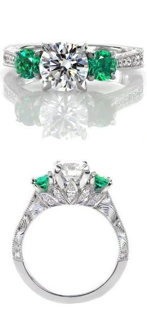 Three stone engagement rings are timeless! These green emerald sides stones give the perfect pop of color to this antique inspired design. www.knoxjewelers.biz