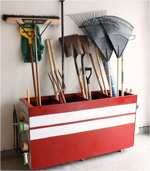 Repurpose an old metal filing cabinet. Paint, remove drawers, and voila! Garage/lawn equipment storage!  Pinned from PinTo for iPad 