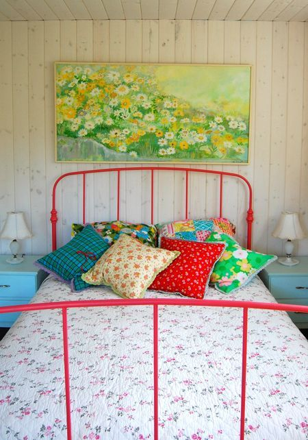 red iron bed, colorful bedroom  Wonder if Tim would let me spray paint the bed........
