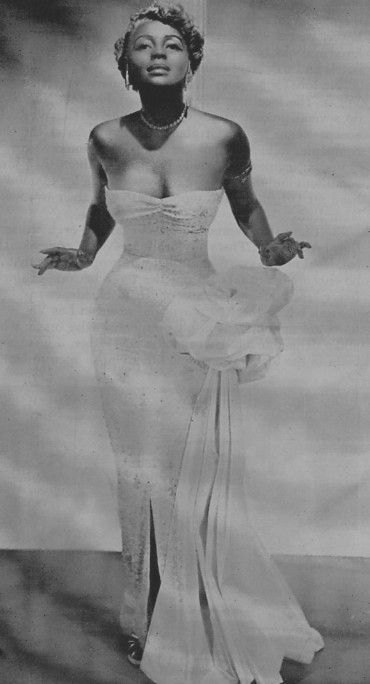 """With the perfect hourglass figure, backless dresses and silver tinted hair, jazz singer Joyce Bryant became known as  """"The Bronze Blonde Bombshell."""""""