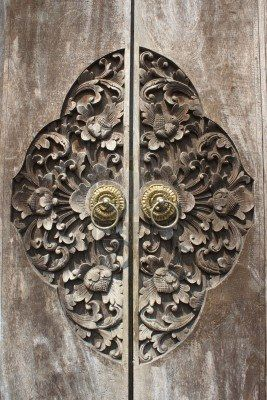Detail of carved wooden door, Bali//