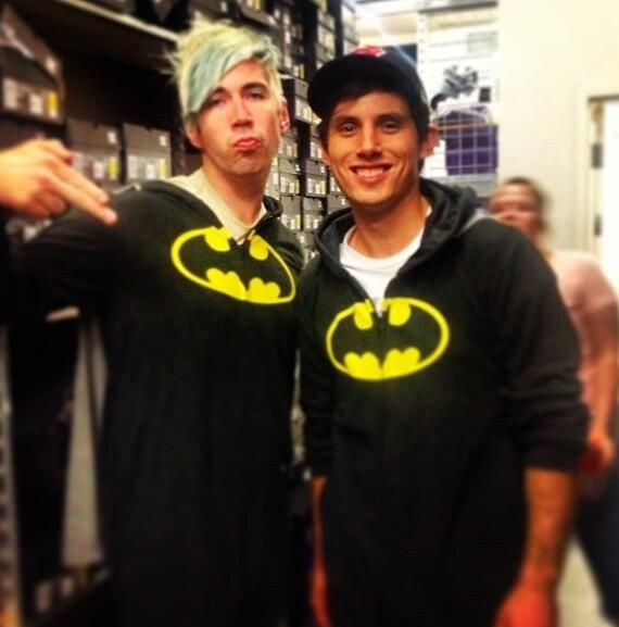 Josh Ramsay and Matt Webb wearing matching batman onesies at a signing