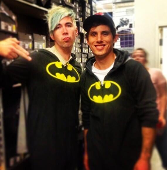 Josh Ramsay and Matt Webb wearing matching batman onesies at a signing