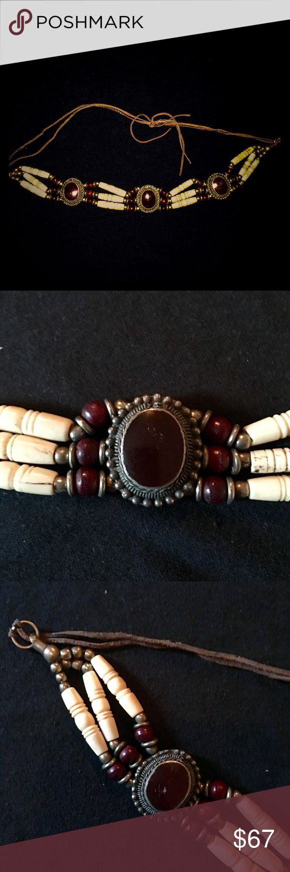 Native American Choker This handmade Native American choker is a must add for that native, boho, hippie look. Silver and burgundy beads, burgundy stones, and bone on leather. Take home this one of a kind piece. Jewelry Necklaces