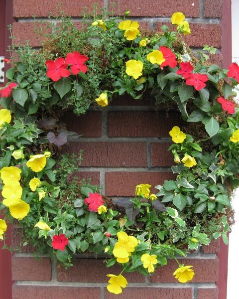 Filled with soil, sheer pantyhose make a great, flexible base for a floral wreath.