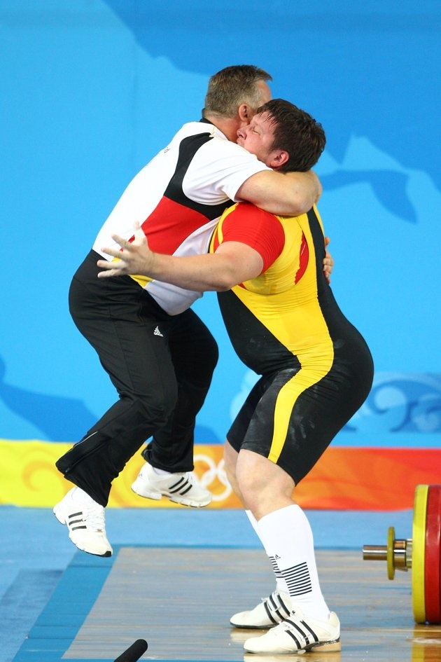 Inspirational Moments: Olympic celebrations - BEIJING - AUGUST 19: Matthias Steiner of Germany celebrates winning the gold medal in the Men's 105 kg group weightlifting event with his coach Frank Mantek at the Beijing University of Aeronautics & Astronautics Gymnasium on Day 11 of the Beijing 2008 Olympic Games on August 19, 2008 in Beijing, China. (Photo by Julian Finney/Getty Images)