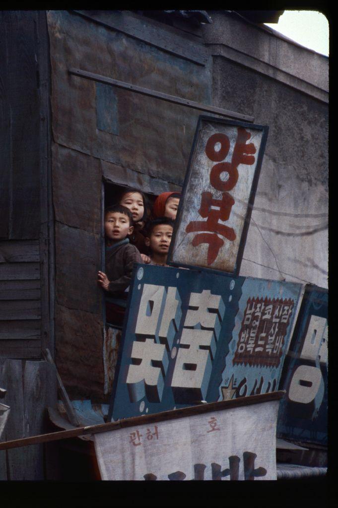 Kids watch funeral cortege of Queen Yun. Korea, Seoul, 13 Feb 1966   Photo by Stephen Dreher.