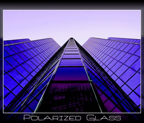 ~ Local Downtown Ottawa Building and one of my favourites to photograph. ~I used a Circular Polarizing filter to counter the polarized glass on this building. ~Purplish Theme~My Monday image, hope your weekend was great and that Monday is a perfect start to a great week .Good day other side of world