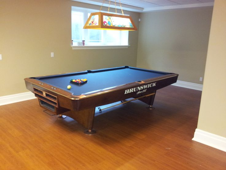 Pool Table Ideas traditional billiard room with custom black felt pool table and dark walnut glossy furnished wooden pool You Can Never Go Wrong With A Brunswick Gold Crown Pool Table Covered In Marine Blue