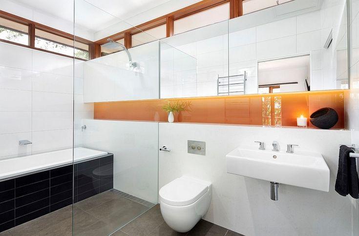 Modern Melbourne bathroom with a dash of orange - Decoist