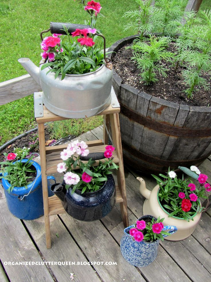 vintage teapot collection - garden decor http://organizedclutterqueen.blogspot.com/2012/06/vintage-pumps-more-futon-parts-outdoor.html#