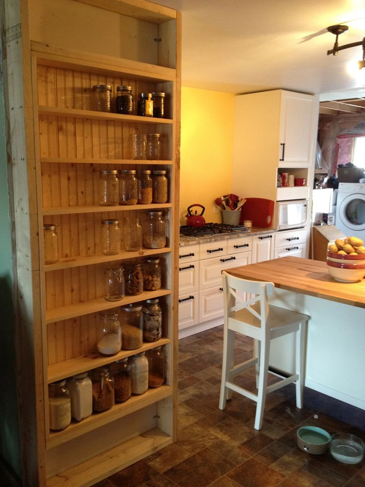 Mason Jar Spice Rack. Maybe use over-the-door shelves in the pantry?