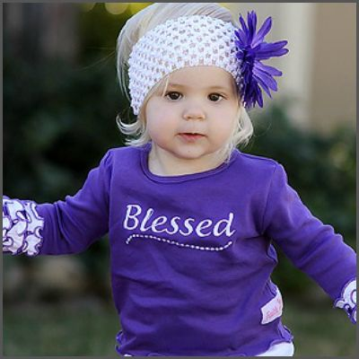 Long Sleeve Ruffle 'Blessed' Top. Sure to be a show stopper, elegant yet casual enough for everyday wear, this sweet grape & white long sleeve top is embroided with 'Blessed' across the front and detailed with 3 gorgeous wrist ruffles, matched with our grape and white ruffled knit crawlers, your little angel will shine!