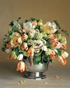 Tulip and Peony Arrangement | Martha Stewart Living - For this delicately colored display, Kevin Sharkey combined silky tulips; green snowball viburnums; large, single-petaled peonies; and the velvety foliage of scented geraniums.