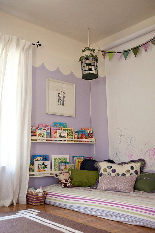 A Gallery of Children's Floor Beds- I like the book rack next to the bed, and the giant drawing paper roll