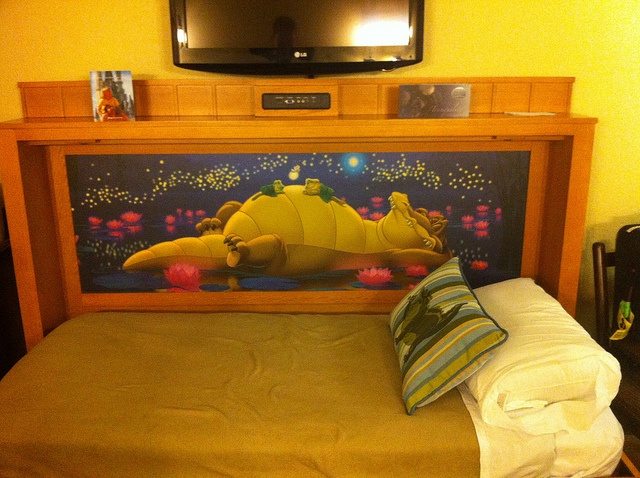 Disney's Port Orleans Riverside  - This is a view of the hidden trundle bed folded down from the bench into the bed format! SO COOL!