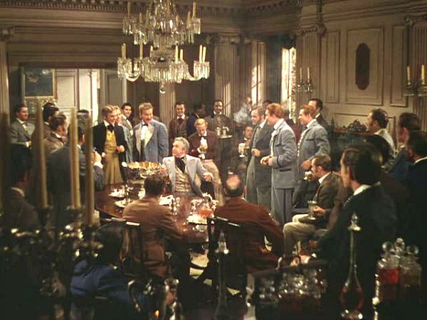 Twelve Oaks war meeting  - the menfolk talk politics and drink brandy while the ladies 'nap' before the evening ball.