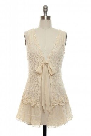such a cute lace vest...I wonder if I could pull it off?