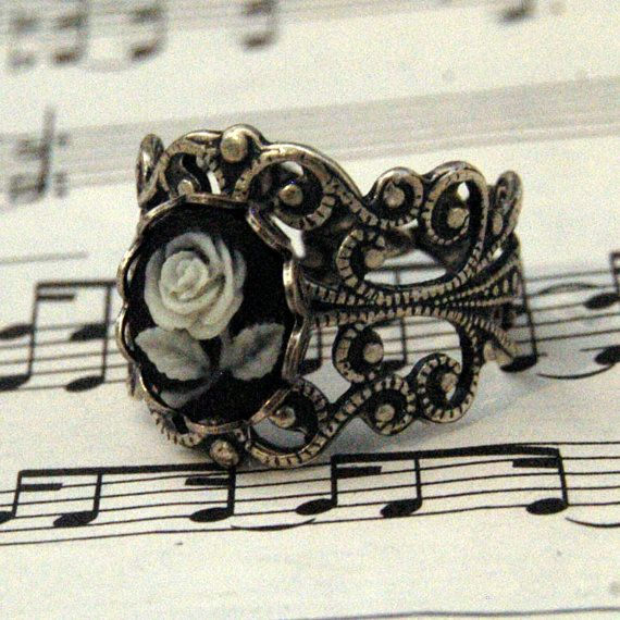 THIS is what I call a ring!!!! Gorgeous!    Rose Cameo Ring by ragtrader on Etsy $17.00. <3