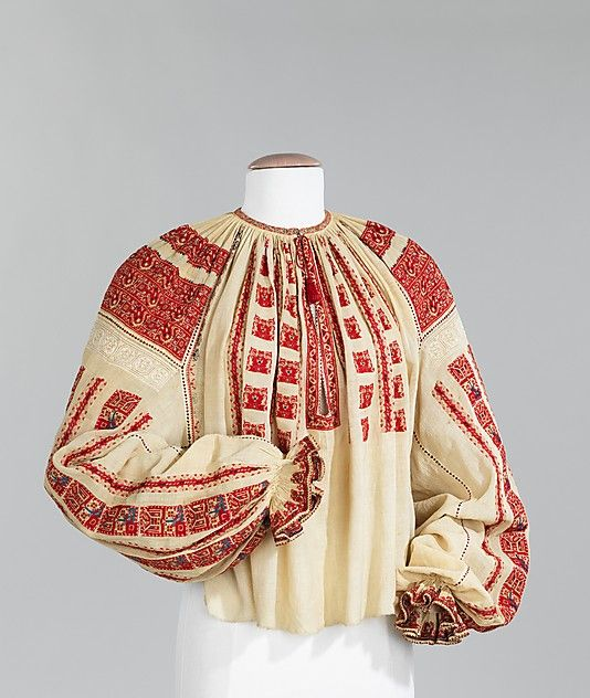 The disposition of embroidery on this blouse is distinctly Romanian. Dense bands of geometric motifs over the shoulders and vertical bands below alternating with drawnwork bands are quintessentially Romanian. Henri Matisses friendship with painter Teodor Pallady sparked his interest in Romanian folk costume. This type of blouse was a recurring theme in Matisses work.