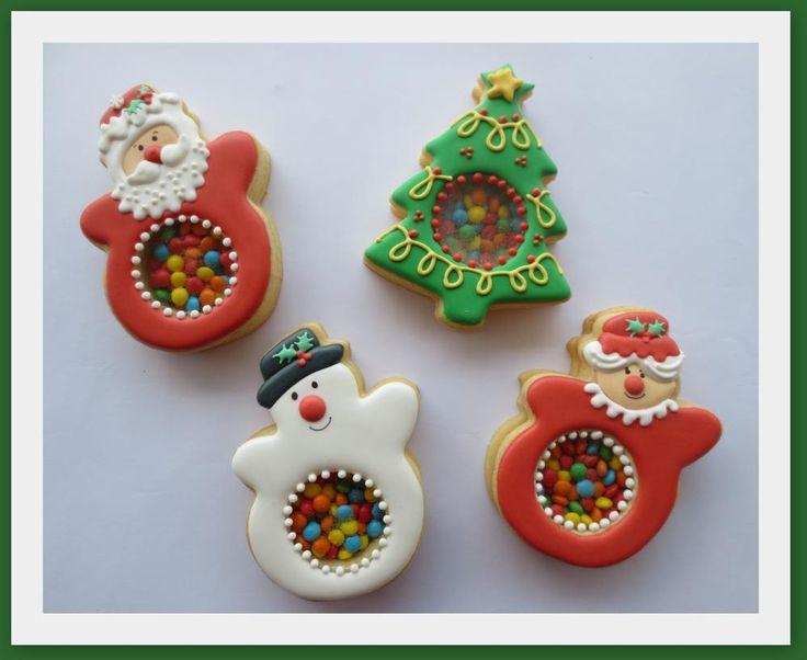 "Christmas Piñata Cookies by Alison Friedli, posted on Cookie Connection. Alison used Isomalt to make the ""windows""."