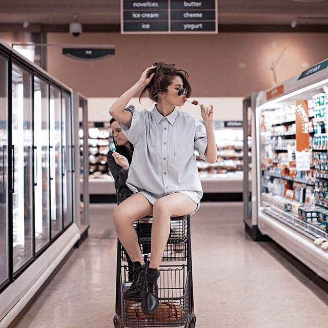 Pin for Later: 12 Signs You're a Selena Gomez Fan You Relate to Her on a Daily Basis The best thing about Selena is how down to earth she comes across, like when she's staging photo shoots with her friends during grocery store runs.
