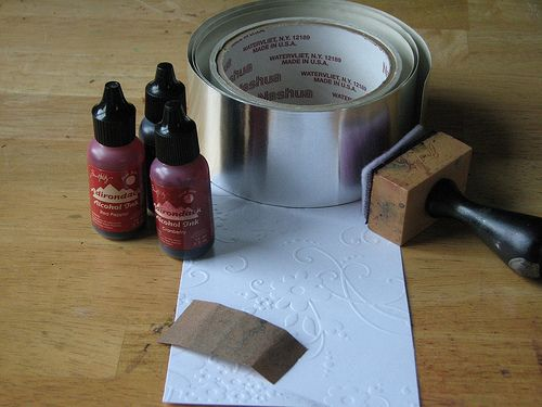 Embossing using aluminum foil tape, a rolling pin, and various templates.