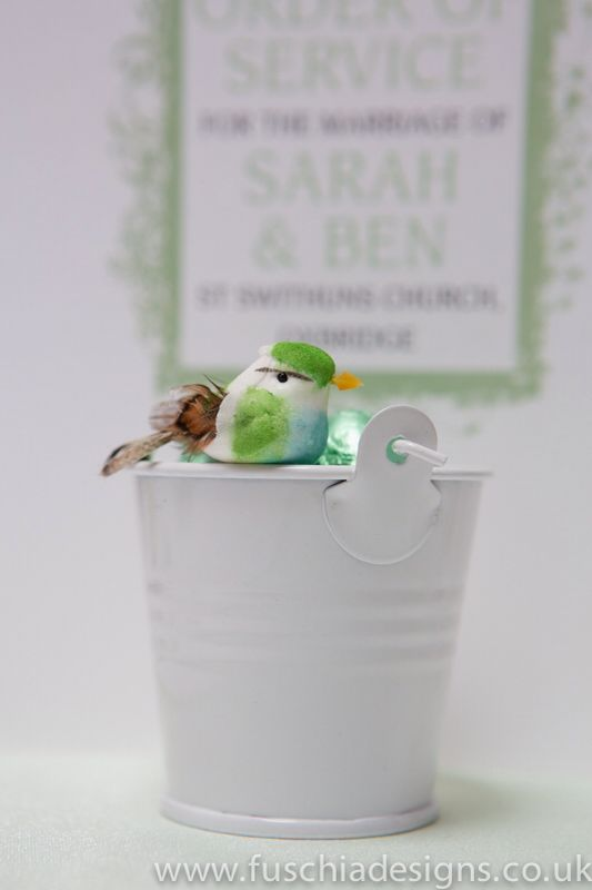 Peppermint green wedding favour. Favour pail with milk chocolate hearts decorated with a cute bird. Very en trend for a woodland theme wedding. www.fuschiadesigns.co.uk