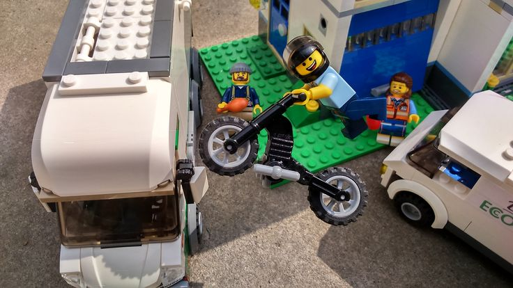 My favourite Lego picture so far.  Using the right camera angle, I created the illusion of being photobombed by Dan!  I've started to customize two vans and include them as a teaser.