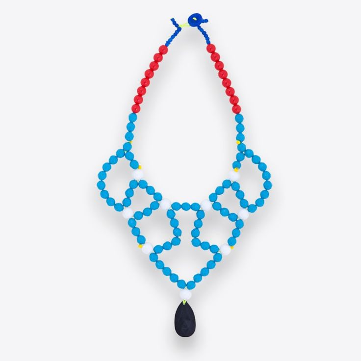 For this necklace composed of a variety of colorful chunky acrylic beads sourced from her native Athens, designer Christina Darras found inspiration in Mondrian's paintings and the way he used the three basic colors (red, yellow, blue) in order to create a whole language of communication. The shape of the necklace is based on the traditional Greek embroidery and crochet patterns and, as the designer herself says, it is