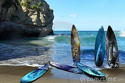 Several surf tables on a beach, waiting for the surfers. Each surf table is decorated with a different illustration, all of them related with the sea. Those illustrations can be found in Dreamstime.com