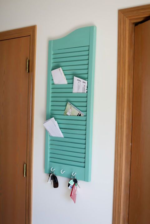 The spaces between shutter slats offer an easy way to organize mail, plus the simple addition of hooks at the bottom creates the perfect place to hang keys. Get the tutorial at Samantha Elizabeth.