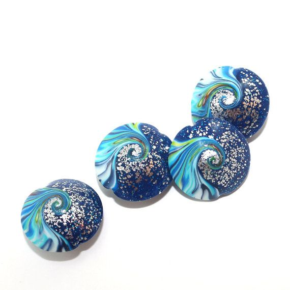 polymer clay swirl lentil in blue turquoise