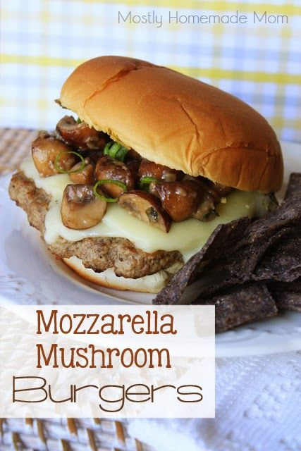 Grilled burgers topped with sliced mozzarella, and yummy mushrooms sauteed in garlic and Parmesan! www.mostlyhomemademom.com