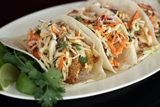 Amazing healthy baked fish taco recipe... The cabbage honey chipotle slaw is the best part!!