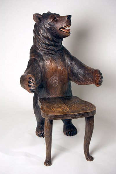 A Pair of Black Forest Bear Armchairs - A very important and rare pair of bear armchairs, modeled as a male and female bear standing facing each other, circa 1870. Note the excellent coloring to the bear's bellies.  Height: 43 inches
