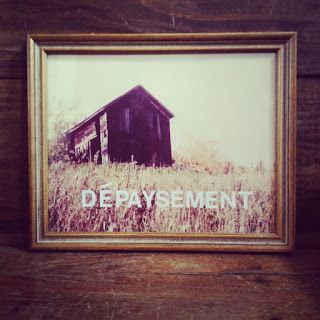 """This is something I made for the decor in my house this summer, but it totally works in the classroom.  I went to a thrift store nearby and found an old, framed picture (for $4.99!) stuck some adhesive letters on it, and BAM: something pleasant.  (""""Depaysement"""" is a French word for the feeling that comes from not being in one's home country. This neat article has a list of other cool words that you could use for an etymology lesson, or just for fun!)"""
