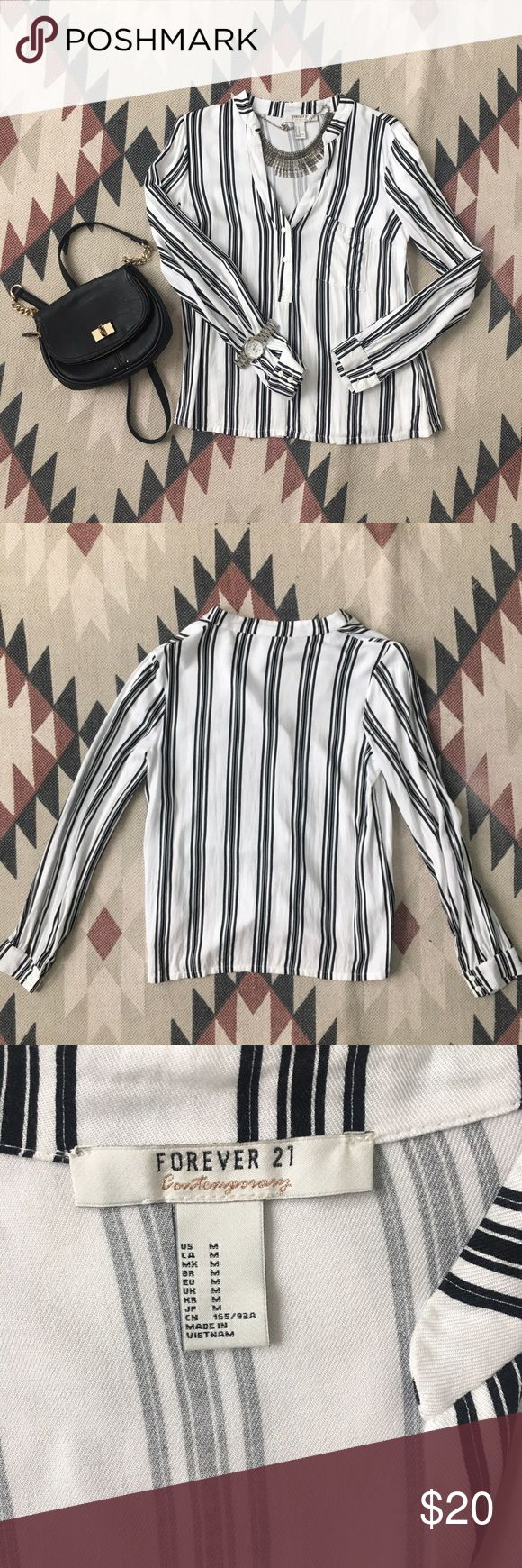 🦋Forever21 V Neck Stripped shirt🦋 Size: M Brand: Forever21 Color: Black/White  Condition: Excellent  Damage: None   Terms & Conditions: ✩ Ship day after purchase ✩ Delivery in 2-5 business days with USPS ✩ Scammer Warning: No Trades / $3 listings ✩ Allergy Warning: Smoke free / Pet free home Forever 21 Tops Button Down Shirts