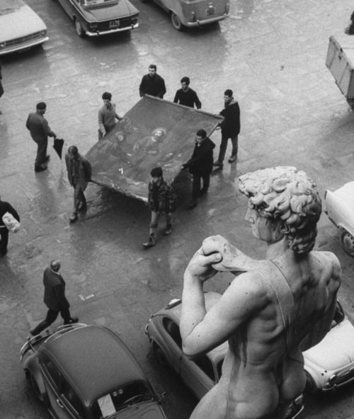 Piazza della Signoria, 1966  Florence, Italy  Relocating painting after massive flooding in Florence